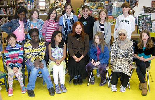 students with Phoebe Stone at the Haggerty Schoolin Cambridge, MA